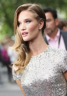 neutral face with strong cheekbones. side swept hair. she is so pretty!