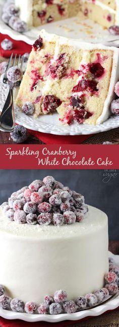 Sparkling Cranberry White Chocolate Cake - super moist vanilla cake full of fresh cranberries, iced with white chocolate icing and topped with sparking cranberries!: