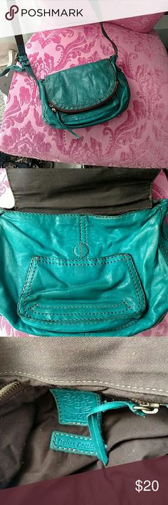 Teal lucky leather purse Long strap lucky bag loved. Coloring has darkened on the front of the bag. I put a cute lucky charm pin on the flap zipper. Price reflects condition. Lucky Brand Bags Crossbody Bags