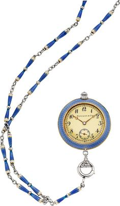 Tiffany & Co. Lady's Diamond, Enamel, Platinum, Gold Pendant Watch circa 1915  Case: 30 mm, platinum and 18k gold, guilloche enamel with rose-cut diamond accents, sapphire winding crown