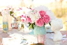For one thing I am a BIG sucker for garden roses but then to have them in a pale aqua vase!! Just gorgeousness...