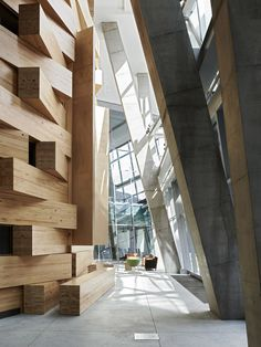 """""""A three storey timber 'nest' sits within the structure, made from giant chunky lumps of timber beams and housing various teaching rooms. Photo – Eve Wilson for The Design Files."""""""