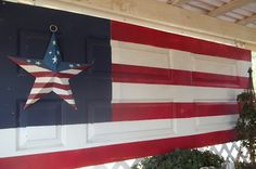 from Ribbonwood Cottage. an old door painted like a flag. Old Garage, Savvy Southern Style, Old Doors, Front Doors, Garage Doors, Shutter Doors, Patriotic Decorations, Down South, Painted Doors