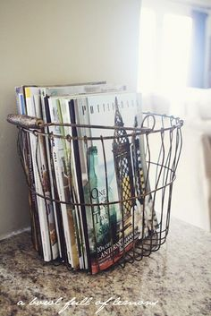 basket from hobby lobby to hold magazines... like the vintage cottage feel