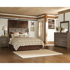With sophisticated details, pewter-colored hardware and an aged brown, rough sawn finish over replicated oak grain, the Signature Design 'Juararo' 4-Piece Queen Bedroom Set from Ashley will add gorgeous vintage casual design to your home. The large-scaled collection includes a queen panel headboard, dresser, mirror and one nightstand.