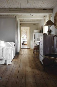 Cozy bedroom. Rustic floors and furniture.