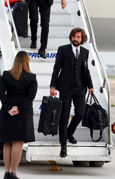 Andrea Pirlo Photos - Andrea Pirlo of Italy arrives in Brazil ahead of FIFA 2014 World Cup at on June 2014 in Rio de Janeiro, Brazil. - Team Italy Arrives in Brazil Dapper Gentleman, Gentleman Style, Suit Fashion, Mens Fashion, David Beckham Style, Andrea Pirlo, Football Fashion, Three Piece Suit, Sharp Dressed Man