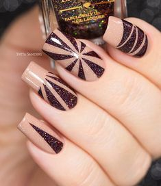 Make patterns with darker shades on beige base. Add different pattern to each nail and the result would be awesome!
