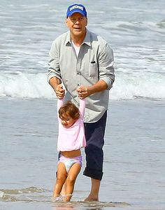 Bruce Willis playing with daughter Mabel, 21 Months at Malibu Beach. 25 February 2014