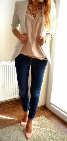Blush pink blouse, under a white blazer, paired with some skinny jeans, a skinny belt and blush pink heels.