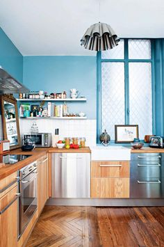 A fresh pop of color is an eclectic way to bring height into a space, as well as your personalized design style! This kitchen inspiration from blogger Glitter Inc. will give you all the ideas you need to renovate the central room in your home.