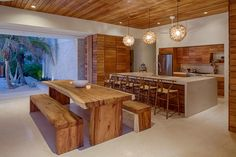 Beautiful wood paneling wraps this dining area and kitchen in warmth and organic harmony. In the tropical setting of Tulum, Mexico, the walls can disappear to let the indoors and outdoors blend.
