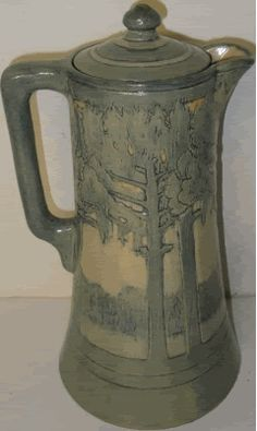 This Newcomb College Tankard/Coffee by LeBlanc sold for $6300 in February 2010. The artist is Marie de Hoa LeBlanc, I believe, who was at Newcomb College from 1909-1914. She won several big awards during the early 1900's