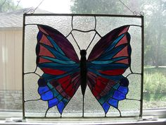 Large stained glass butterfly.  I used the copper foil method and framed in zinc.