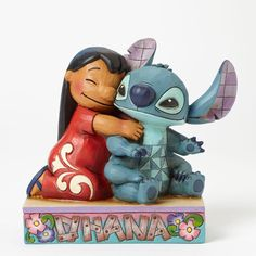 """Name: Lilo and Stitch Title: """"Ohana Means Family"""" Introduction: April 2014 Item Number: 4043643 Material: Stone Resin Dimensions: 4.875in H x 2.75in W x 5.75in L Weight: 1.05 lb Lilo and Stitch come t"""