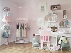 Adorable girly girl's bedroom for your little one who loves pink! Fill the room with simple furniture like a small rack and pink chair and use clothing and toys to decorate! A simple & sweet design!