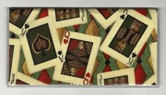 """Scattered Poker Playing Deck of Cards Checkbook Cover by Tickled Pink Boutique. $5.00. The sturdy clear VINYL COVER encases a fabric bonded design. Measuring 6 1/4"""" x 3 1/4"""",  the cover fits all standard bank checkbooks and banking registers.  All checkbook covers come with a register flap and a duplicate check flap  just like the bank, only flashier.  These checkbook covers are a great alternative to the expensive covers offered by banks and online check companies."""