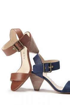 Leather mid heel sandals with triangle-shaped heels and metal hardware in brown and navy