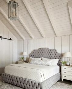 wood planked walls and ceilings in vaulted master bedroom