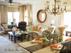 A Stroll Thru Life: 2015 Summer Home Tours-My Home: Notice the kitchen table and CHAIRS.  Eating area flows into a family room. Colors kept neutral with only accent pieces, napkins & pillows with color. This makes it easy to change colors quickly.