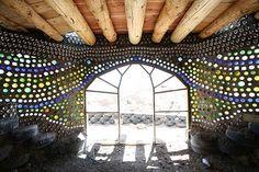 Glass bottle wall in earthship