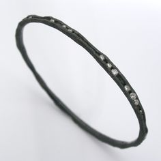 """VIA facerejewelryart.com Todd Pownell: , Bracelet in oxidized sterling silver with channel set diamonds (approx. 1.40 tcw). 2.375"""" in diameter."""
