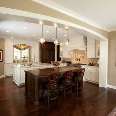 Tan Walls, white trim, dark cabinets, dark floors