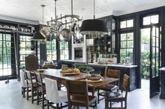 """How to make your house feel like a home: """"Paint a kitchen a sophisticated and dramatic shade like navy or charcoal— and you'll transform it into a space that is handsome by day and glamorous by night."""""""