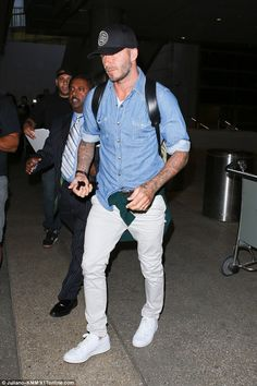 Man of style! As usual, Beckham looked fashionable in a jean shirt and white trousers
