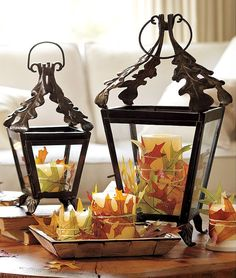 Tie fake autumn leaves around simple candles with twin for a warm, rustic look. Paired with Iron/iron looking lanterns with leaf accents and wood plates/table. Autumn Home Decor Accessories Fall Home Decor, Autumn Home, Unique Home Decor, Diy Autumn, Autumn Crafts, Fall Lanterns, Candle Lanterns, Jar Candles, Flameless Candles
