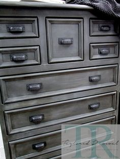 Graphite with a French Linen wash. Hand painted in Graphite , direct dark waxed, we then created a a french linen wash by adding water in with French linen Chalk Paint™ then further detailed with dark wax pounced over selected areas, creating a silvery patina to the finish.