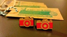 Snap Happy Wooden Camera Earrings available in orange, white, red, black, blue and purple. Handmade jewellery, lasercut from upcycled wood. by BoughtoBeauty on Etsy