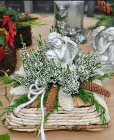Small arrangement with heather, pinecones and an angel. Casket Flowers, Grave Flowers, Cemetery Flowers, Funeral Flowers, Funeral Floral Arrangements, Flower Arrangements, Centerpiece Decorations, Xmas Decorations, Funeral Caskets