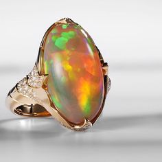 Water Opal Ring with rich tones of red, orange, yellow and green.   KAT FLORENCE