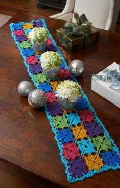 Holiday Party Table Runner Crochet Pattern | Red Heart - Crochet a table runner that will set the stage for festive holiday gatherings. We've shown it using six shades of sparkly yarn, but it would work well in whatever colors you use for decorating. FREE PATTERN