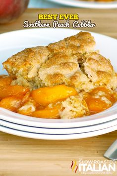 The Best Ever Southern Peach Cobbler--Fresh sweet peaches baked in a spiced sugar mixture and topped with the most amazing cobbler topping.  Sprinkled with sugar for a caramelized topping.  It is heaven on a plate.