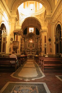 Santa Maria in Portico, Naples.  The interior plan is on a Latin cross, with a nave, three chapels on each side and transept.  The floor is a 17th century terracotta tiled with marble insets.