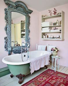 I absolutely ADORE this mint and strawberry bathroom... that clawfoot tub, that mirror, that popping red rug... gorgeous