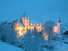 Castle Hotel Thannegg, an idyllically situated and romantically white dream castle in the midst of the Austrian Alps