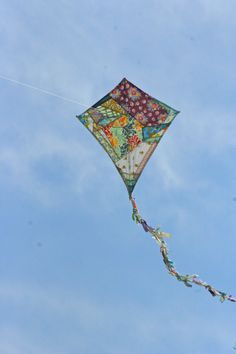 Make a homemade kite and then fly it with your kids!