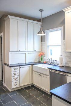 Black soapstone Kitchen with white subway tile backsplash | CROCODILE ROCKS