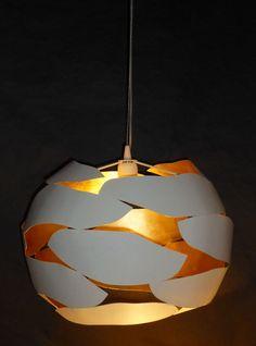 Suspension en métal découpé de Jean-Philippe Nuel. Blanc mat et doré. Ceiling light by Jean-Philippe Nuel. Carved steel, matt white and golded. #lightings #design