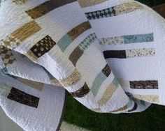 This handmade patchwork quilt was made using the Pure fabric collection by Sweetwater for Moda.