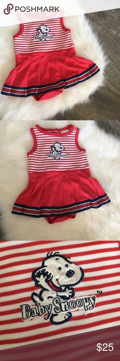 Baby snoopy cheer outfit Baby snoopy cheer outfit. Super adorable and unique snoopy outfit, snap bottom indie with a attached skirt, two buttons on upper back for easier on/off, previously worn and has normal wash and wear, small fraying on snoopy (see pictures) otherwise in good condition. One Pieces