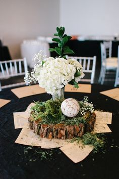 woodsy inspired centerpiece - photo by Sarah Libby Photography http://ruffledblog.com/modern-black-and-white-wedding-with-emerald
