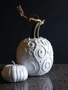 Halloween Pumpkin Decorating : Give your pumpkin a pretty, modern look with this swirly, all-white design.