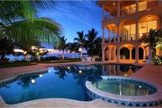 Love the pool layout and the arches on the house, and not to mention its on the beach.