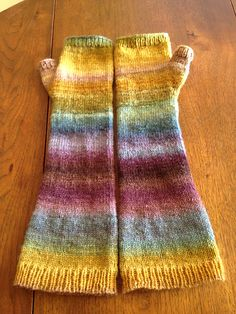 hand knit fingerless mits out of hand spun yarn