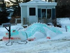 13 Coolest Yard Snow Sculptures - ODDEE...This family created the best yard pet ever.