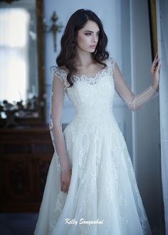 Romantic A-line wedding dress. Bateau neck bodice with paillettes overlaid with…